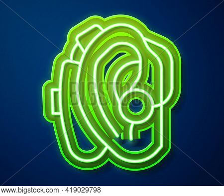 Glowing Neon Line Hearing Aid Icon Isolated On Blue Background. Hearing And Ear. Vector