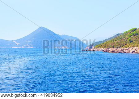 Blue Bay With Mountains . Kotor Bay With Sailing Boats . Coastal Balkans Mountains