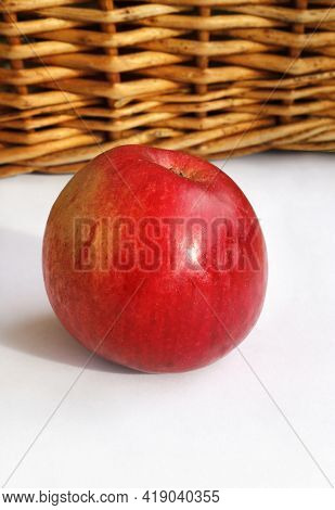 Ripe Red Appetizing Apple Close Up On A Basket And White Background