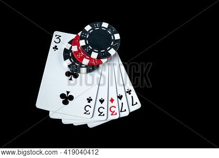 Poker Game With Full House Or Full Boat Combination. Chips And Cards On The Black Table In Poker Clu