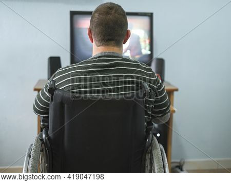 Disabled Guy Watching Movie On Computer At Home During Lockdown Time, Medical Tech