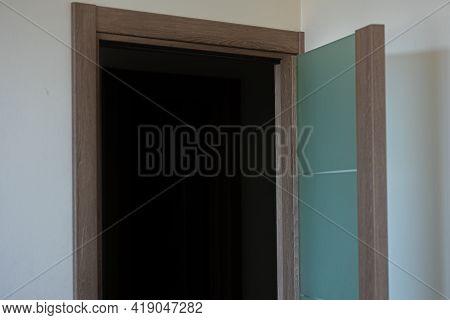 Open Glass Door In Green In The Room. Wooden Doors Trim.