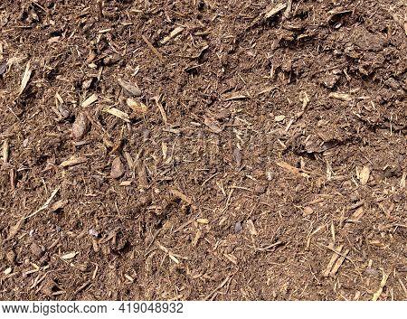 Fresh Topsoil Dirt In Filled Frame Format For Lawn Maintenance