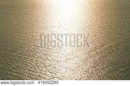 Aerial View Texture Of Golden Sea Surface With Small Waves In The Sea And Beautiful Light Sunset Or