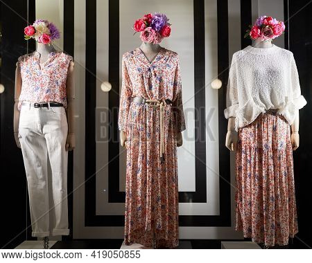 Showcase Mannequin In Shop Window Showing Women Attire, Storefront With Womens Clothing And Shoes, M