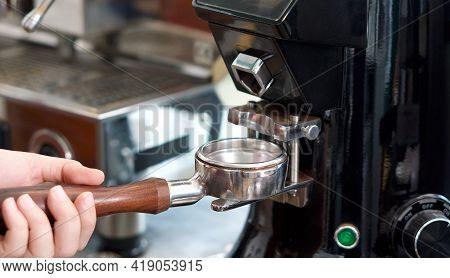 Barista Making Fresh Espresso Coffee. Espresso Machine Portafilters (closeup).