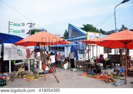 Indonesian People And Foreign Travelers Walking Buy Sell Food Product And Travel Visit Local Bazaar