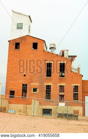 Abandoned Grain Elevator And Factory Taken In An Economically Depressed Town In The Midwest