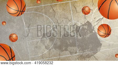 Composition of multiple basketballs in air over basketball court cracked distressed surface. sports and competition concept digitally generated image.
