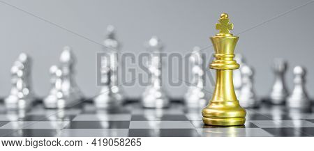 Gold Chess King Figure On Chessboard Against Opponent Or Enemy. Strategy, Conflict, Management, Busi