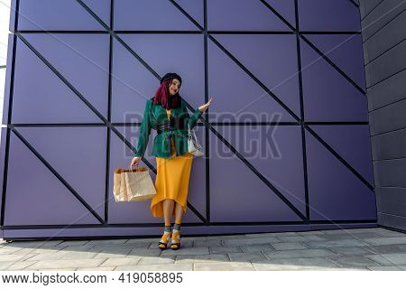 A Happy Shopaholic Girl Throws Her Bags Near A Shopping Center. Have Fun Shopping On Black Friday. T