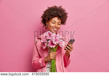 Glad Afro American Lady In Stylish Clothes Checks Messages Online Gets Congratulations On Birthday H