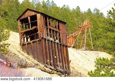 Abandoned Mining Mill On A Mountainous Slope Surrounded By A Pine Forest Taken In The Historical Min