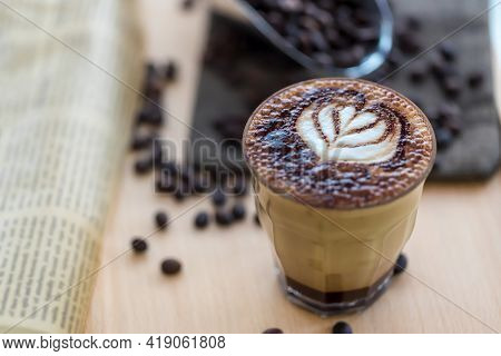 Coffee Latte Art. The Coffee Arts. Hot Coffee In A White Cup On Wooden Table. Hot Chocolate Nutella
