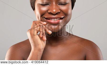 Enjoy Your Beauty. Portrait Of Happy Black Woman With Beautiful Flawless Skin