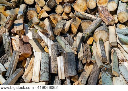 Wooden Chocks For Kindling The Fireplace. Natural Wood Background.