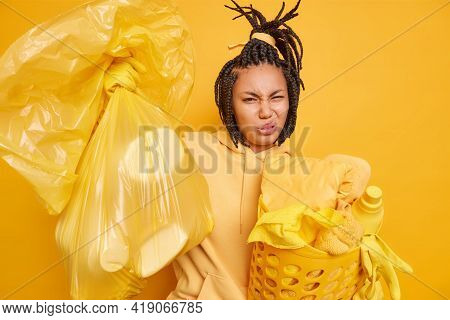Photo Of Displeased Young Afro American Woman Smirks Face From Aversion Cannot Stand Unpleasant Stin