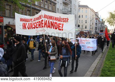 Berlin, Germany - May 01, 2021: Protesters Holding Banners At 1st May Demonstrations On The Streets