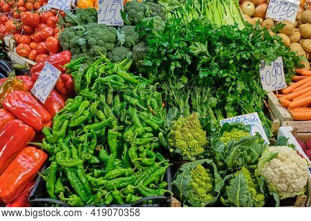 Chili, Broccoli And Other Vegetables For Sale At A Market