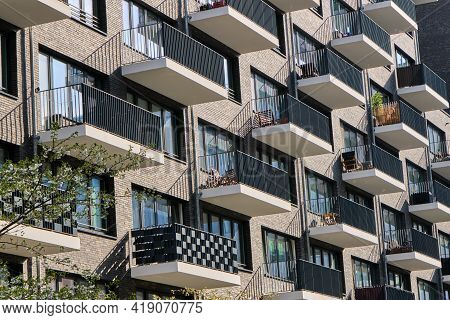 Detail Of The Facade Of A Modern Apartment Building With Many Balconies