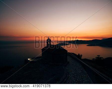 Church Sveti Savva Near Island Sveti Stefan At The Sunrise Time.