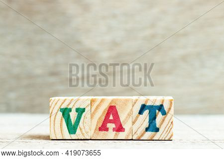 Alphabet Letter Block In Word Vat (abbreviation Of Value Added Tax) On Wood Background