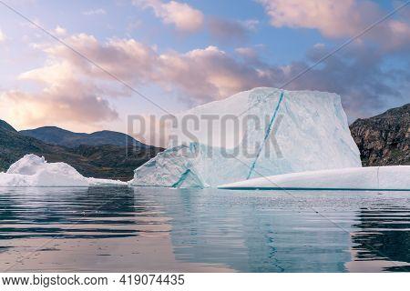 Big Blue Iceberg Reflecting In Water Floats In The Sea By Broughton Island, Nunavut, Canada. Boat Ri