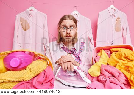 Emotive Shocked Redhead Man Stunned To Have Much Work About House Busy Ironing Clothes And Laundry A