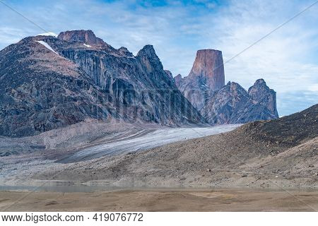 Iconic Granite Rock Of Mt.asgard Towers Above Turner Glacier In Remote Arctic Valley Of Akshayuk Pas