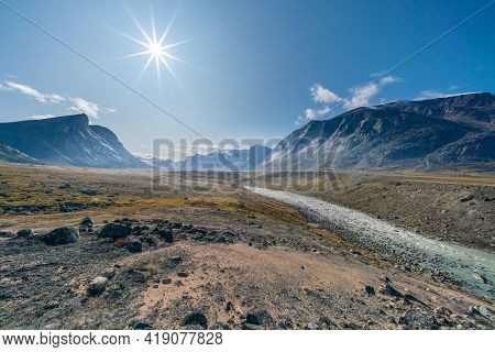Stream Winds Through Wild Arctic Landscape In Akshayuk Pass, Baffin Island, Canada. Moss Valley Floo