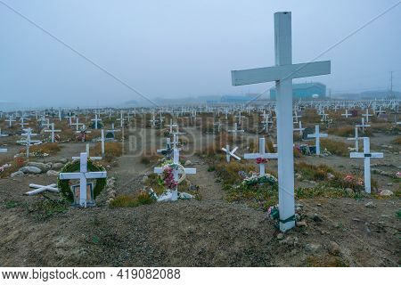 Old Graveyard With White Wooden Christian Crosses In Remote Inuit Community Of Pangnirtung, Nunavut,