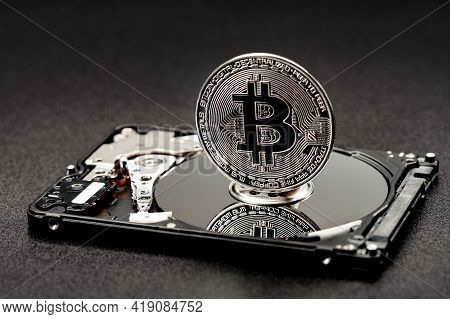 Bitcoin On A Hard Disk On A Black Background, The Concept Of Mining Cryptocurrencies Using Hard And