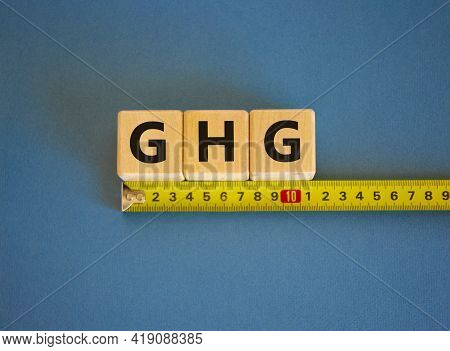 Ghg, Greenhouse Gas Level Symbol. The Word Ghg, Greenhouse Gas On Cubes Arranged Behind The Ruler On