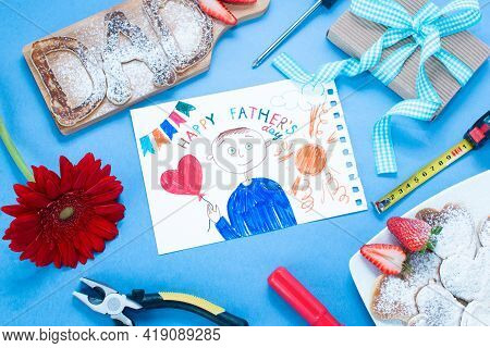 Father Day Breakfast Pancakes Dad Letters, Gift, Building Tools On A Blue Background. Childs Drawing