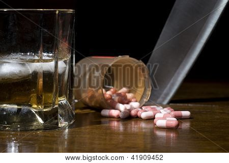 Pills, Alcohol And Knife