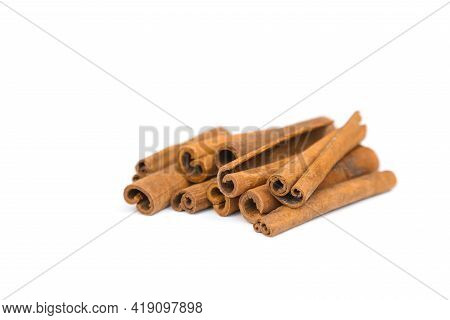 Stack Of Cinnamon Sticks Isolated On White Background. Closeup, Cinnamon Sticks A Lot.