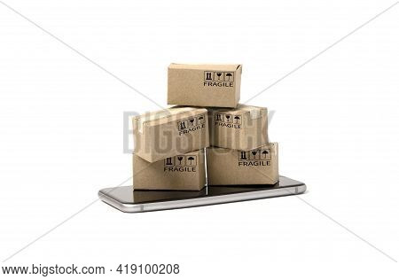 Isolated Of Small Cartons Box  On Smartphone  For Online Shopping And E-commerce Concept.