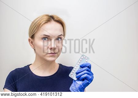 Gynecologist Holds A Pack Of Oral Contraceptives In His Hand