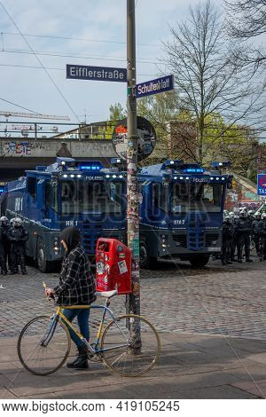 Hamburg, Germany - May 1, 2021: Water Cannons And Riot Police On The Side Of A Demonstration On May