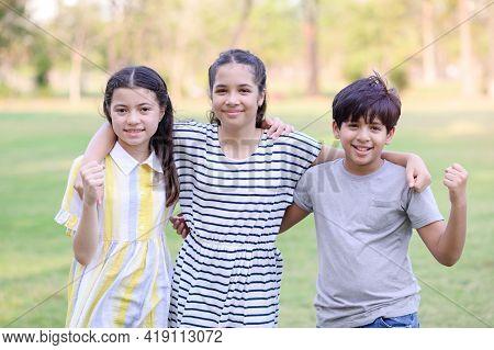 A Half-thai-indian Boy And A Half-thai-european Girl Friend Show Off Unity In A Park While Learning