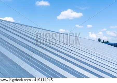 Roofs Metal Sheet Cloud Blue Sky Background, Concept Construction Roof.