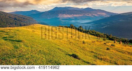 Rural Landscape With Fields On Hills. Mountainous Nature Scenery In Summertime At Sunrise. Glowing C