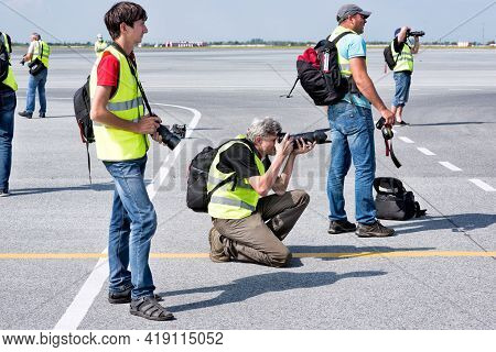 Abakan, Russia - August 08, 2020: Photographers Taking Pictures Of The Airplanes Taking Off At Airpo