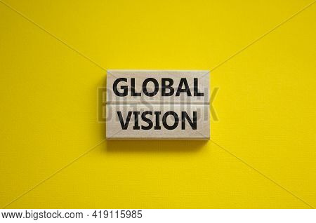 Global Vision Symbol. Wooden Blocks With Words 'global Vision' On Beautiful Yellow Background. Busin