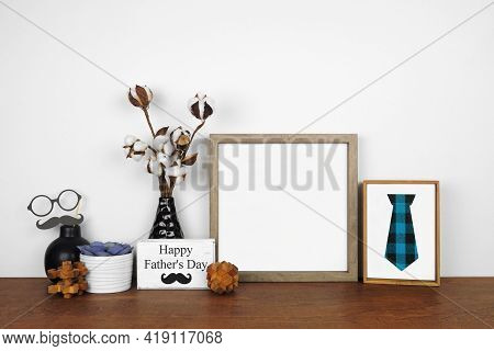 Mock Up Wood Frame With Rustic Fathers Day Theme Decor. Wood Shelf Against A White Wall. Copy Space.