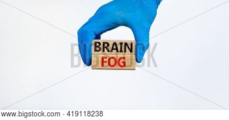 Medical And Covid-19 Pandemic Coronavirus Brain Fog Symbol. Doctor Holds Wooden Blocks With Words 'b