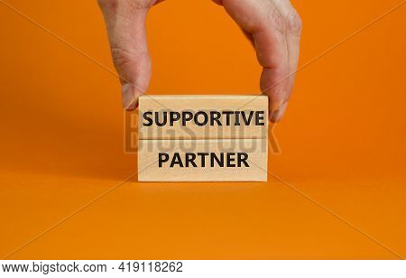 Supportive Partner Symbol. Wooden Blocks With Words 'supportive Partner' On Beautiful Orange Backgro