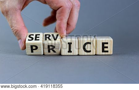 Service Price Symbol. Hand Turns A Cube And Changes The Words 'service' To 'price'. Beautiful Grey B