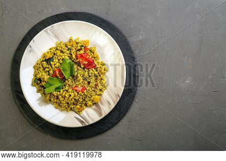 Food For Suhoor In Ramadan Bulgur Post With Vegetables In A Plate On A Gray Background. Horizontal P