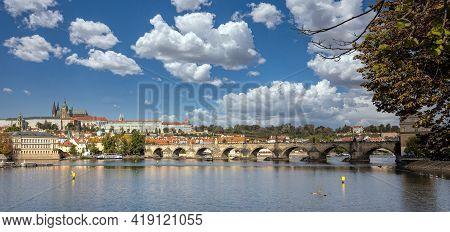 Prague, Czech Republic. Danube River And Charles Bridge In A Spring Sunny Day, Cloudy Blue Sky Backg